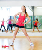 Smiling trainer working out in the gym Stock Images