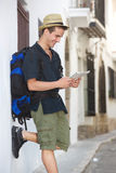 Smiling travel man looking at map outside Stock Photography