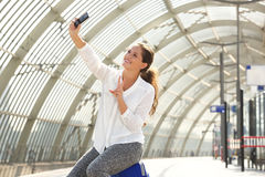 Smiling travel woman taking selfie Royalty Free Stock Photography