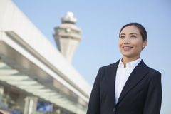 Smiling Traveler looking at sky at airport Royalty Free Stock Image
