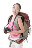 Smiling traveling Asian girl holding a camera Royalty Free Stock Photos