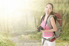 Smiling traveling Asian girl Royalty Free Stock Photography