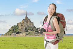 Smiling traveling Asian girl Stock Photography