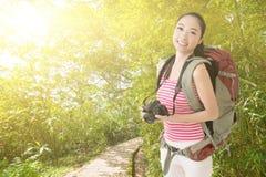 Smiling traveling Asian girl Royalty Free Stock Image