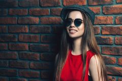 Smiling trendy girl Royalty Free Stock Photos