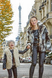 Smiling trendy mother and child in Paris, France. Boiling hot trendy winter in Paris. smiling trendy mother and child in Paris, France Royalty Free Stock Images