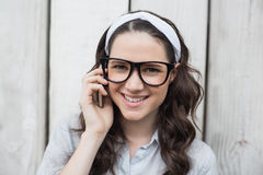 Smiling trendy woman with stylish glasses having phone call Stock Photo