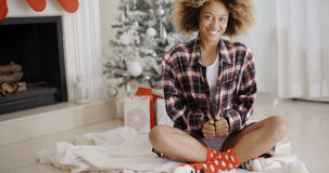 Smiling trendy young woman enjoying Christmas Royalty Free Stock Photos