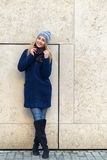 Smiling trendy young woman in winter fashion Stock Photo