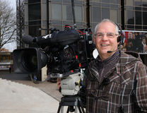 Smiling TV cameraman Stock Photography