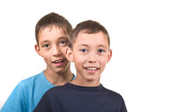 Smiling twins isolated Stock Photos