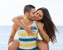 Smiling two having date on sandy beach Stock Photo