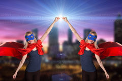 Smiling two woman in superhero costume. Royalty Free Stock Photos