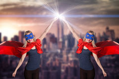 Smiling two woman in superhero costume. Royalty Free Stock Photo