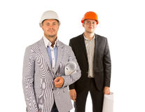 Smiling Two Young Male Engineers Looking at Camera Stock Photography