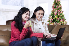 Smiling two young woman with laptop Stock Images