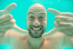 Smiling underwater man portrait Royalty Free Stock Photography