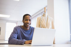Smiling university student using laptop Royalty Free Stock Photo