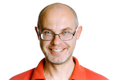 Smiling unshaven man on a white background with glasses Stock Images