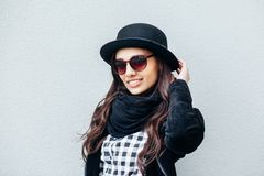 Smiling urban girl with smile on her face. Portrait of fashionable gir wearing a rock black style having fun outdoors Stock Images