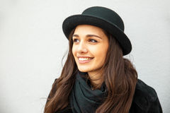 Smiling urban girl with smile on her face. Portrait of fashionable gir wearing a rock black style having fun outdoors in the city Royalty Free Stock Photo