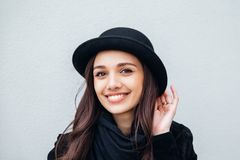 Smiling urban girl with smile on her face. Portrait of fashionable gir wearing a rock black style having fun outdoors Royalty Free Stock Photos