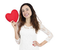 Smiling valentines day woman showing a red heart. Smiling valentines day and love woman holding a red heart, isolated on white background Stock Image