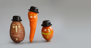 Smiling vegetable characters. Mister potato, miss carrot and gentleman onion with funny faces black hat. Vegan family. Smiling vegetable characters. Mister Stock Photos