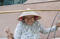 Smiling Vietnamese street hawker Stock Photo