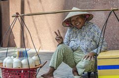 Smiling Vietnamese street hawker Royalty Free Stock Images