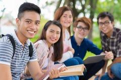 Smiling Vietnamese student. Portrait of smiling Vietnamese student on the background of his cheerful classmates Stock Images