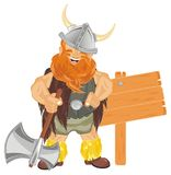 Viking with ax and banner. Smiling viking hold an ax and stand near of clean wooden banner Royalty Free Stock Image