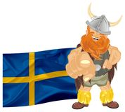 Viking and colored flag. Smiling viking stand with large Switzerland flag and show gesture Royalty Free Stock Images