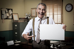 Smiling vintage businessman holding a blank sign Stock Photos
