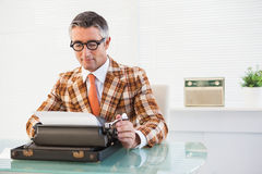 Smiling vintage man using typewriter Royalty Free Stock Photos