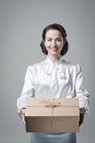 Smiling vintage woman with mail package Royalty Free Stock Image