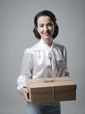 Smiling vintage woman with mail package Stock Photography
