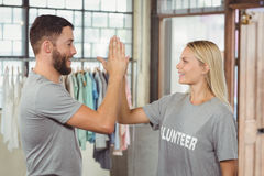 Smiling volunteer doing high five in office royalty free stock photo