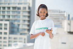 Smiling volunteer holding tablet pc Royalty Free Stock Images