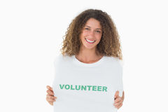Smiling volunteer showing her tshirt to camera Royalty Free Stock Photography