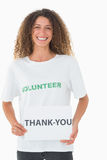 Smiling volunteer showing a thank you poster Stock Images