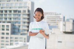 Smiling volunteer woman holding clipboard Stock Photography