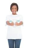 Smiling volunteer woman holding glass jar Royalty Free Stock Image