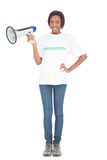 Smiling volunteer woman holding megaphone Stock Images
