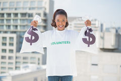 Smiling volunteer woman holding money bags Royalty Free Stock Photos