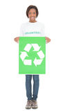 Smiling volunteer woman holding recycling sign Stock Image