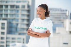 Smiling volunteer woman posing Stock Photos