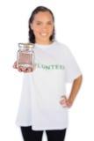 Smiling volunteer woman showing jar Stock Photos