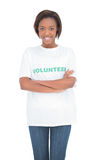 Smiling volunteer woman standing crossing arms Royalty Free Stock Photography