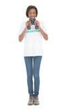 Smiling volunteer woman using binoculars Stock Photo